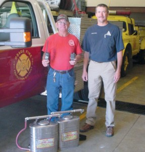 Missouri Department of Conservation Resource Technician Michael Schulte and OFPD Chief Dennis Braun.