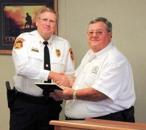 FFAM President Kenneth Hoover presents Fire Marshal Randy Cole with a certificate of appreciation