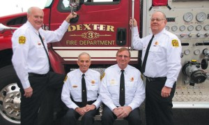 These four members of the Dexter Fire Department represent 151 years of service. From left to right: Fire Chief Don Seymore, Assistant Fire Chief Dave Rowe, Captain Dale Rowe and Captain John Jenkins.