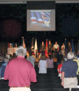 Audience participates in the Pledge of Allegiance.