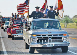 The Ozark Firefighters Association Color Guard leads the rally parade.