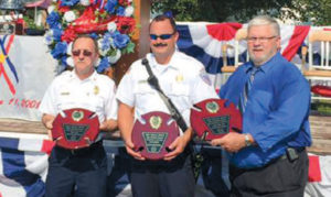 Cedar Hill Fire Protection District Fire Chief Terry Soer, Lieutenant Mick Fischer and the District Board President with their County Awards.